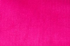 Closeup of seamless pink knitted fabric texture. textiles, top view. royalty free stock photo