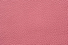 Closeup of seamless pink leather texture. For background Royalty Free Stock Image