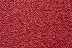 Closeup of seamless red leather texture. For background Royalty Free Stock Photos