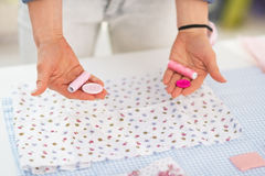 Closeup on seamstress choosing between buttons Royalty Free Stock Photo