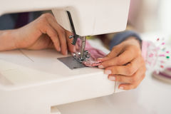 Closeup on seamstress sewing in studio Royalty Free Stock Image
