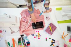 Closeup on seamstress using tablet pc at work Royalty Free Stock Photos