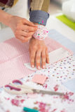 Closeup on seamstress working with fabric Royalty Free Stock Photo