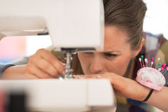 Closeup on seamstress working with sewing machine Royalty Free Stock Photo