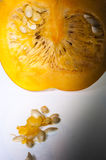 Closeup of an section of orange pumpkin with seeds Stock Photo