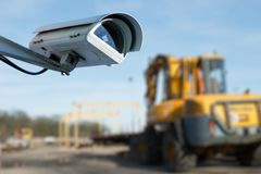 Security CCTV camera or surveillance system with industrial site on blurry background. Closeup on security CCTV camera or surveillance system with industrial royalty free stock image
