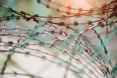 Closeup a security fence with barbed wire. Royalty Free Stock Images