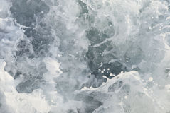 Closeup of seething sea water. Detail of seething sea water with many droplets Stock Image