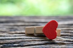 Closeup Selective focus of Red heart wooden Paper Clips with gr. Een nature background and copy space. Ideal for Valentines day, Love and relationship concept stock photography