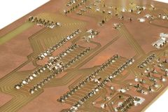 Closeup of a self-made printed circuit board with microcontroller.  Royalty Free Stock Image