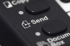 Closeup Of Send Button. On Black With Icon Royalty Free Stock Photography