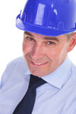 Closeup of a senior bussines man with a blue helmet Stock Photos