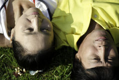 Closeup of senior couple lying on the grass Royalty Free Stock Photos