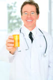 Closeup Senior Doctor Giving Medicine Royalty Free Stock Image