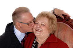 Closeup of senior kissing his wife. Stock Photos
