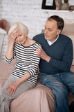 Closeup of senior man consoling his wife Royalty Free Stock Images