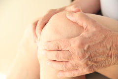 Closeup of senior man with soreness in knee Stock Photography