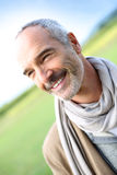 Closeup of senior man standing in countryside Stock Photo