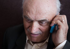 Closeup of senior man talking on mobile phone Royalty Free Stock Photo