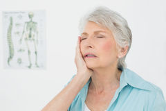 Closeup of a senior woman with eyes closed Stock Images