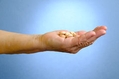 Closeup of senior woman's hand holding medications Royalty Free Stock Image