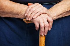 Closeup of senior woman's hands on wooden stick Stock Photo