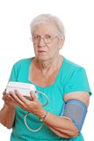 Closeup senior woman use automatic blood pressure Stock Photo