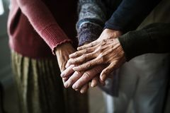 Closeup of seniors hands together teamwork royalty free stock photos