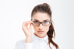 Closeup of serious beautiful young businesswoman in glasses Royalty Free Stock Image