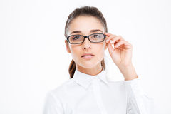Closeup of serious beautiful young businesswoman in glasses Royalty Free Stock Photography