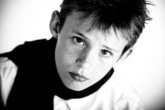 Closeup of serious looking boy Royalty Free Stock Photos