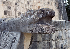 Closeup serpent head on the Platform of the Eagles and Jaquars, Chichen Itza. Pictured is the Platform of the Eagles and Jaguars in Chichen Itza.  It has Stock Photos
