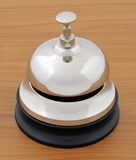 Closeup of service bell on wooden desk Royalty Free Stock Photos
