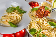 Closeup serving of spaghetti on a plate Royalty Free Stock Images