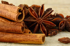 Closeup set of anise and cinnamon on wooden board Royalty Free Stock Photos