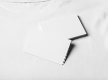 Closeup of set business cards on white tshirt Royalty Free Stock Images