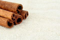 Closeup set of cinnamon on white flax Royalty Free Stock Images