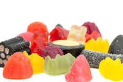 Closeup of several mixed sugary candies. Isolated on white background Royalty Free Stock Image
