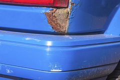 Closeup of Severe Rust and Damaged Bumper on Vehicle Royalty Free Stock Image