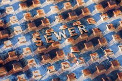Closeup of Sewer Access Cover Stock Photography