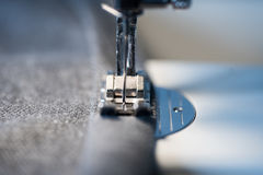 Closeup of sewing machine foot and needle Royalty Free Stock Image