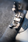 Closeup of sewing machine foot and needle Royalty Free Stock Photo