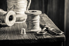 Closeup of sewing table with scissors and threads Royalty Free Stock Photo