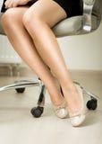 Closeup of sexy businesswomen legs sitting on office chair Stock Photo