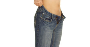Closeup of Chinese woman putting on a pair of jeans. Closeup of Chinese woman putting on a pair of tight jeans royalty free stock photography