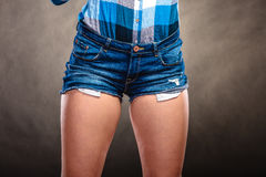 Closeup of sexy woman girl hips wearing shorts. Royalty Free Stock Images