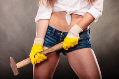 Closeup of sexy woman holding hammer. Feminism. Royalty Free Stock Image