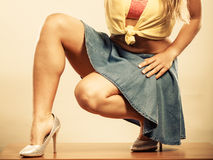 Closeup of sexy woman legs in high heels and skirt Stock Photos
