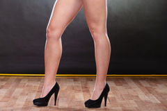 Closeup of sexy woman legs wearing high heels. Royalty Free Stock Photography