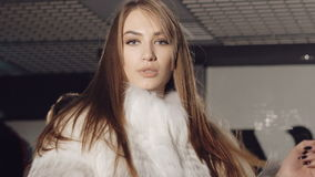 Closeup of women flirting seductive in rich fur coats. Slowly